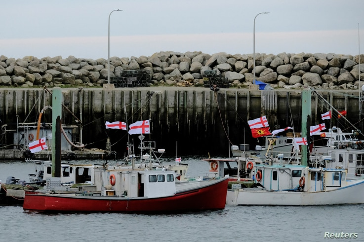 Fishing boats from the Sipekne'katik band, part of the First Nations Mi'kmaw community, who began harvesting lobster outside of…