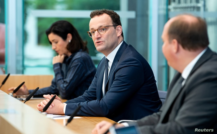 German Health Minister Jens Spahn attends a news conference to give an update on a smartphone app that allows users to evaluate their risk of being exposed to the coronavirus in Berlin, Germany, Sept. 23, 2020.