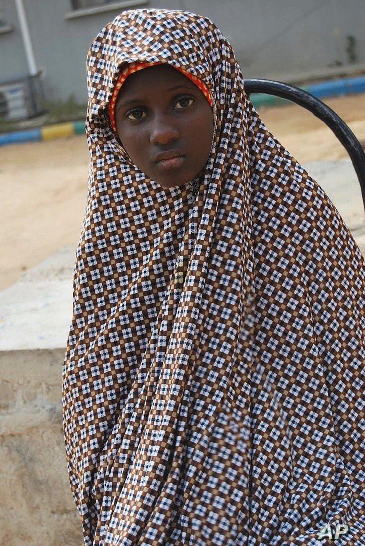 FILE - This Dec. 24, 2014 file photo, shows Zahra'u Babangida, a 13 year-old girl arrested with explosives strapped to her body…