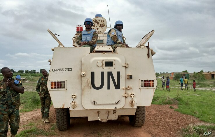 Peacekeepers from the United Nations Mission in the Republic of South Sudan (UNMISS) provide security during a visit of UNCHR...