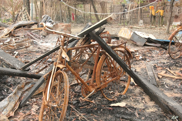 """Burned Rohingya houses are seen in Ka Nyin Tan village of Maungdaw, northern Rakhine state of western Myanmar, on Wednesday, Sept. 6, 2017. Myanmar leader Aung San Suu Kyi's top security adviser sought to counter the storm of criticism the government is facing from around the world over alleged army abuses against ethnic minority Rohingya, asserting that security forces were acting with restraint in pursuing """"terrorists."""" At least 80 houses were burned in Ka Nyin Tan during the violence that broke out on Au"""