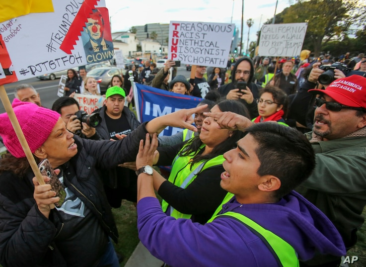 A supporter, right, and an anti-Trump supporter, left, confront each other during a rally, March 13, 2018, in Beverly Hills, California.