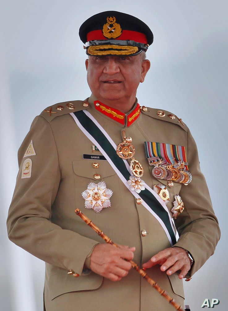 In this March 23, 2019 photo, Pakistan's Army Chief Gen. Qamar Javed Bajwa attends a military parade in Islamabad, Pakistan…