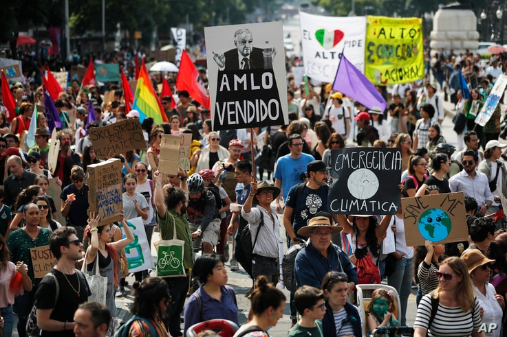 Demonstrators march during the global protest on climate change in Mexico City, Friday, Sept. 20, 2019. Across the globe,…
