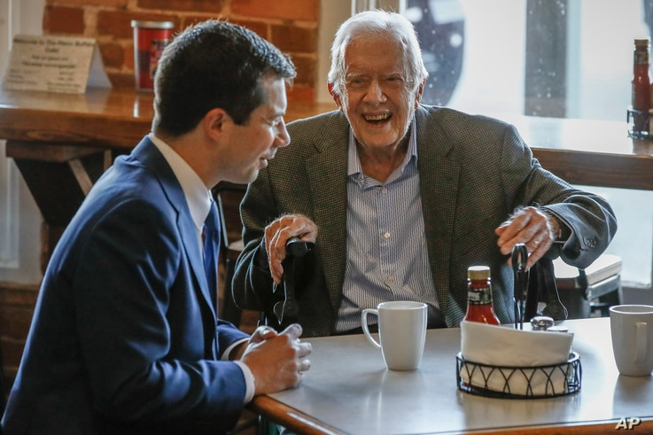 Democratic presidential candidate former South Bend, Ind., Mayor Pete Buttigieg, left, meets with former President Jimmy Carter…