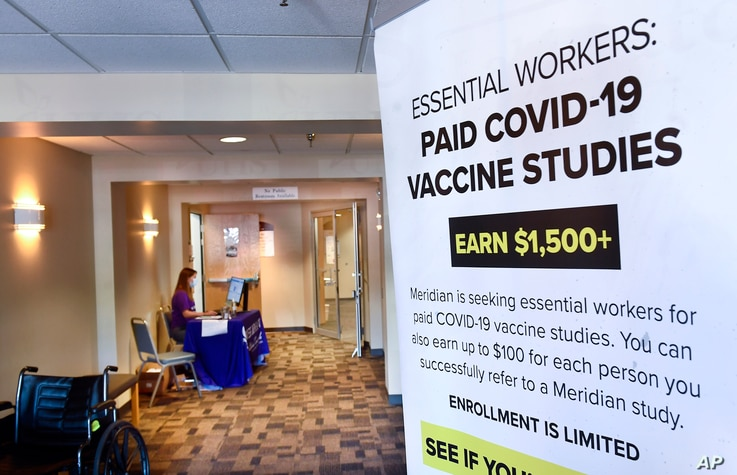 A poster is displayed in the entrance way looking for volunteers as the world's biggest study of a possible COVID-19 vaccine,
