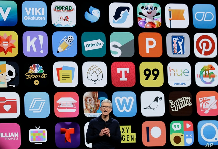 FILE - In this June 4, 2018, file photo, Apple CEO Tim Cook speaks during an announcement of new products at the Apple…