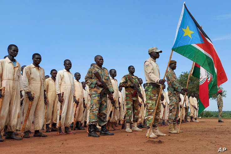 Trainees parade during the visit of the defense minister to a military training center in Owiny Ki-Bul, Eastern Equatoria,…