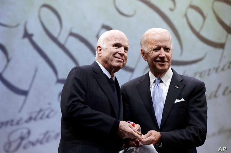 FILE - In this Oct. 16, 2017, file photo Sen. John McCain, R-Ariz., receives the Liberty Medal from Chair of the National…