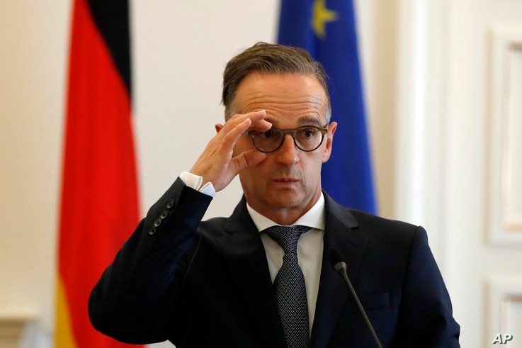German foreign minister Heiko Maas adjusts his glasses during a news conference with his Greek counterpart Nikos Dendias in…