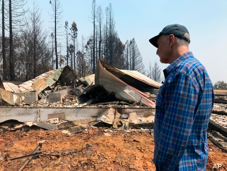 Charles Christianson, a 67-year-old retired school teacher returns to his destroyed home after a wildfire in Guerneville, Calif…