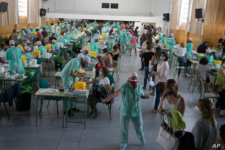 Teachers and auxiliary staff take COVID-19 tests in Madrid, Spain, Wednesday, Sept. 2, 2020. Thousands of Spanish teachers and…