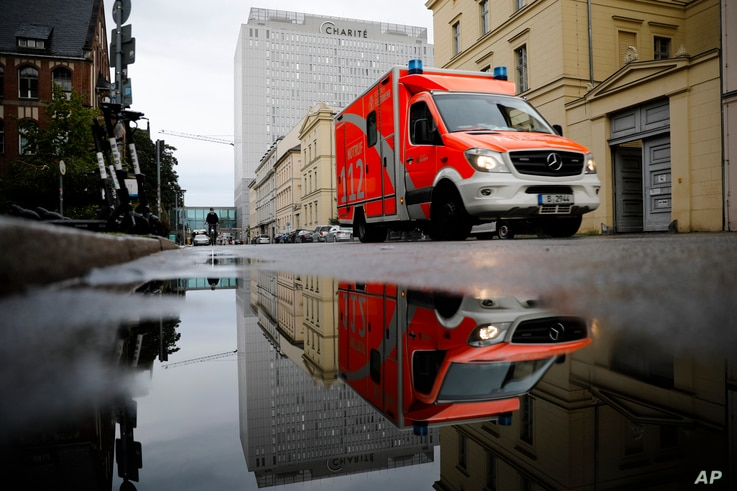 A rescue vehicle drives in front of the central building of the Charite hospital where the Russian opposition leader Alexei Navalny is being treated, in Berlin, Germany, Sept. 2, 2020.