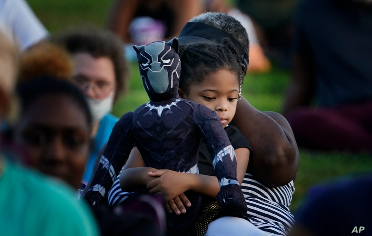 Khloe Murray, 5, of South Carolina, holds her Black Panther doll during a Chadwick Boseman Tribute on Thursday, Sept. 3, 2020,…
