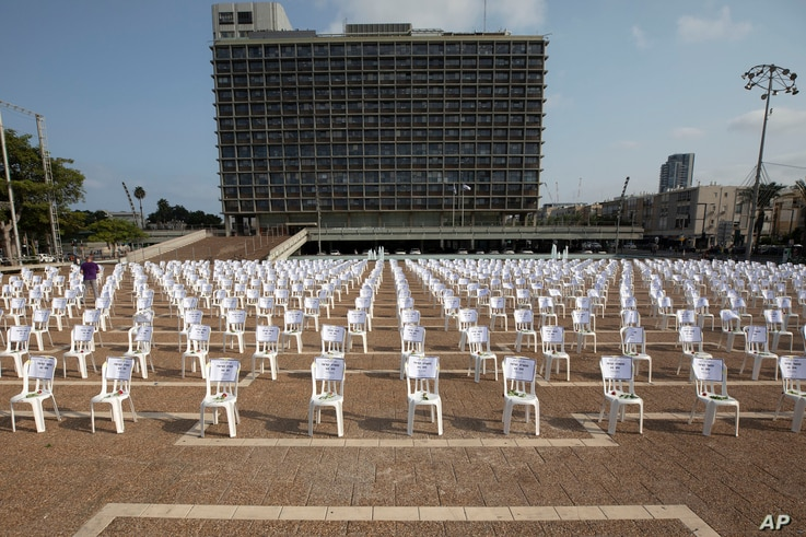 One thousand of chairs symbolizing people died from the coronavirus are placed at the Rabin Square in Tel Aviv, Israel, Monday,…