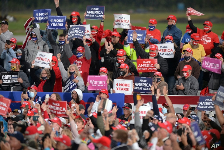 Supporters of President Donald Trump cheer during a campaign rally at MBS International Airport, Thursday, Sept. 10, 2020, in…