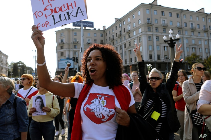 A woman wearing a T-shirt with a sign of an old Belarusian flag during an opposition rally to protest the official presidential…