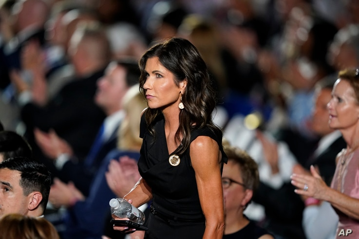 FILE - In this Aug. 27, 2020 file photo, South Dakota Gov. Kristi Noem stands in the crowd on the South Lawn of the White House…