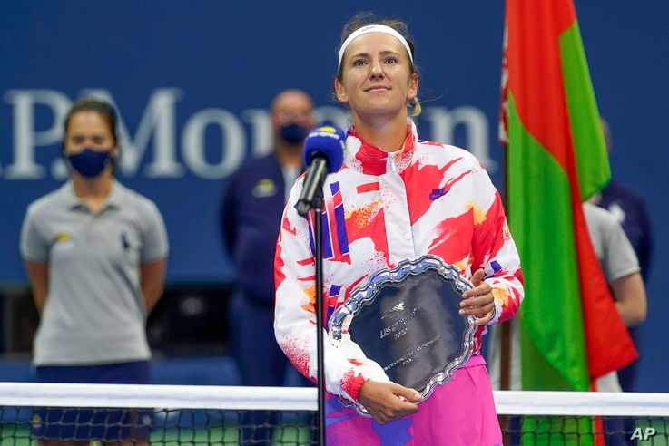 Victoria Azarenka, of Belarus, holds the runner-up trophy after losing to Naomi Osaka, of Japan, in the women's singles final…