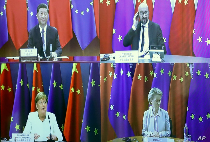 European Council President Charles Michel, top right, speaks with China's President Xi Jinping, top left, European Commission…