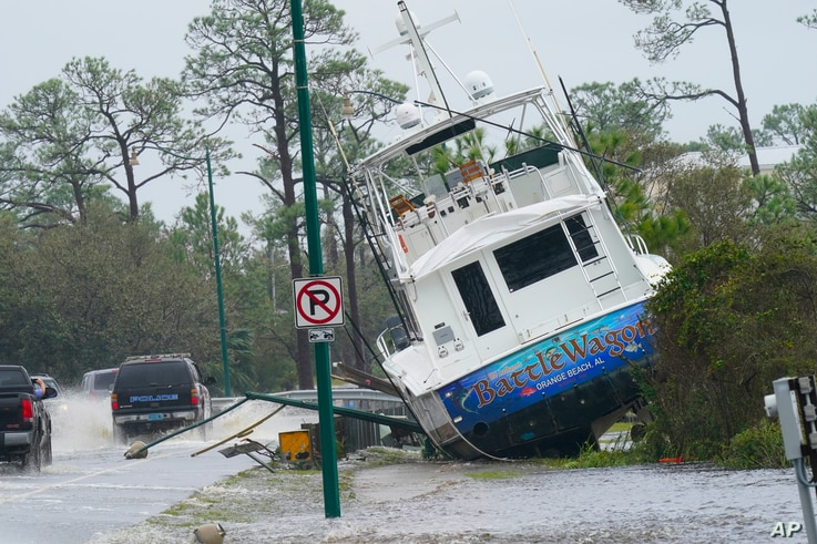 A boat is washed up near a road after Hurricane Sally moved through the area, Wednesday, Sept. 16, 2020, in Orange Beach, Ala…