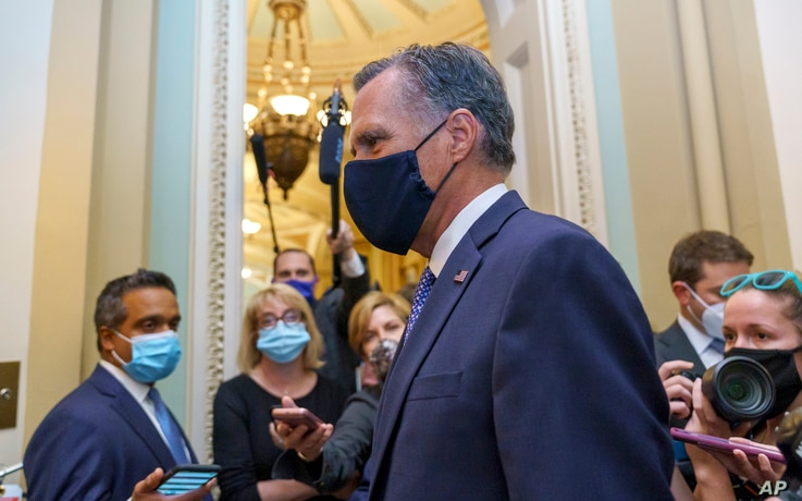 Sen. Mitt Romney, R-Utah, leaves the Senate Chamber following a vote, at the Capitol in Washington, Sept. 21, 2020.