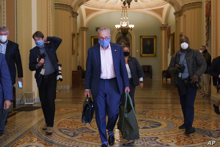 Senate Minority Leader Chuck Schumer, D-N.Y., arrives at the Capitol in Washington, Sept. 21, 2020.