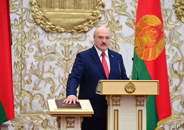 Belarusian President Alexander Lukashenko takes his oath of office during his inauguration ceremony at the Palace of the…