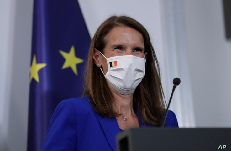 Belgian Prime Minister Sophie Wilmes, wearing a protective mask, prepares to address a press conference following the National…