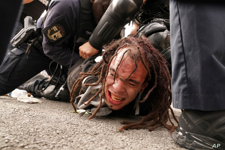 Louisville police detain a man after a group marched, Wednesday, Sept. 23, 2020, in Louisville, Ky. A grand jury has indicted…