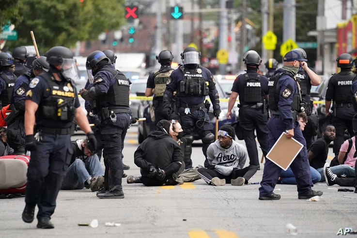 Louisville police detain a a group who marched, Wednesday, Sept. 23, 2020, in Louisville, Ky. A grand jury has indicted one…
