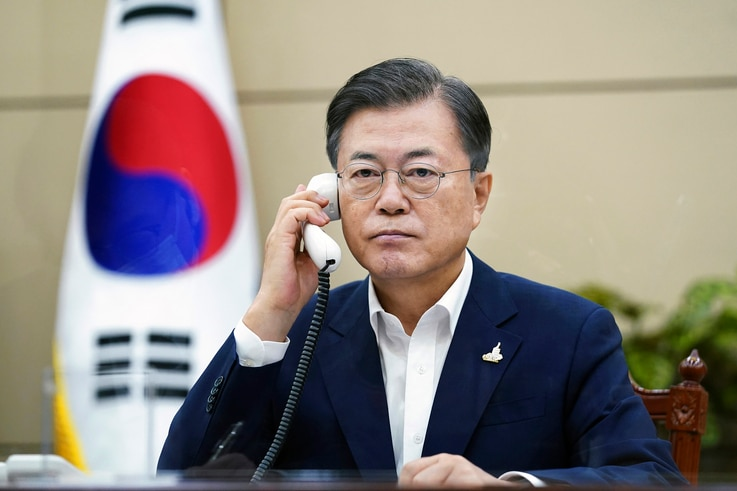 South Korean President Moon Jae-in talks on the phone with Japanese Prime Minister Yoshihide Suga at the presidential Blue House in Seoul, South Korea, Sept. 24, 2020.