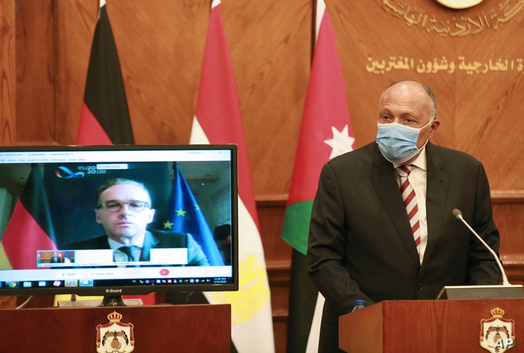 Egyptian Foreign Minister Sameh Shoukry speaks as German Foreign Minister Heiko Maas participates remotely, during an…