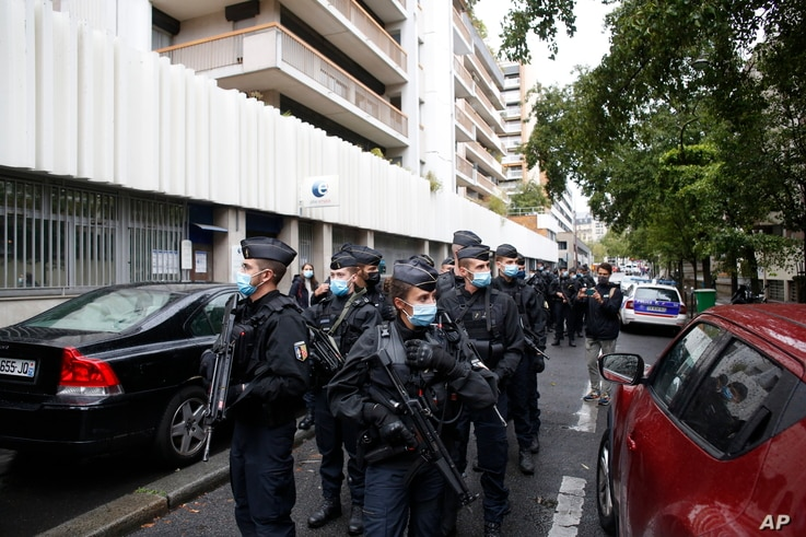French police officers patrol the area after a knife attack near the former offices of satirical newspaper Charlie Hebdo, Friday Sept. 25, 2020 in Paris.