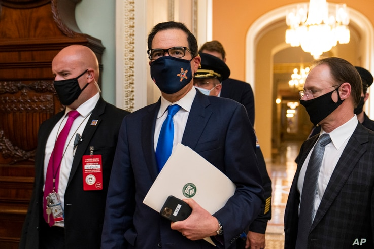 Treasury Secretary Steven Mnuchin, makes a brief comment as he leaves the Capitol, Wednesday, Sept. 30, 2020, in Washington…