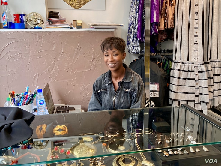 Goutte d'Or fashion designer Dyenaa Diaw has dressed superstar singer Beyonce — but she is staying put in the Paris neighborhood where she grew up. (Lisa Bryant/VOA)