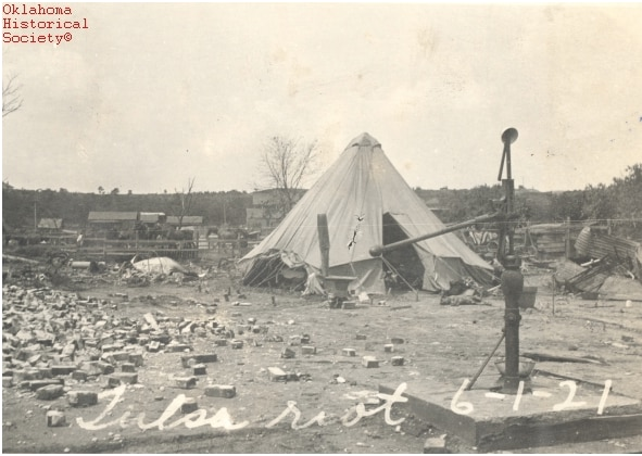 Residents of the Greenwood district of Oklahoma living in tents after White mob violence destroyed the once-thriving African American area.