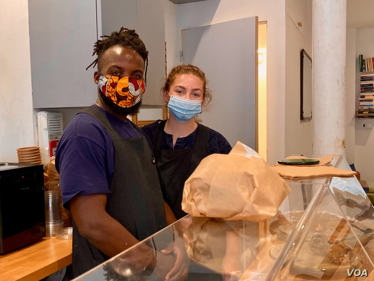 Nigerian Bosun Ola and his partner Fay Latham recently opened the trendy Ola's Cafe, offering another changing face of Goutte d'Or, in Paris. (Lisa Bryant/VOA)