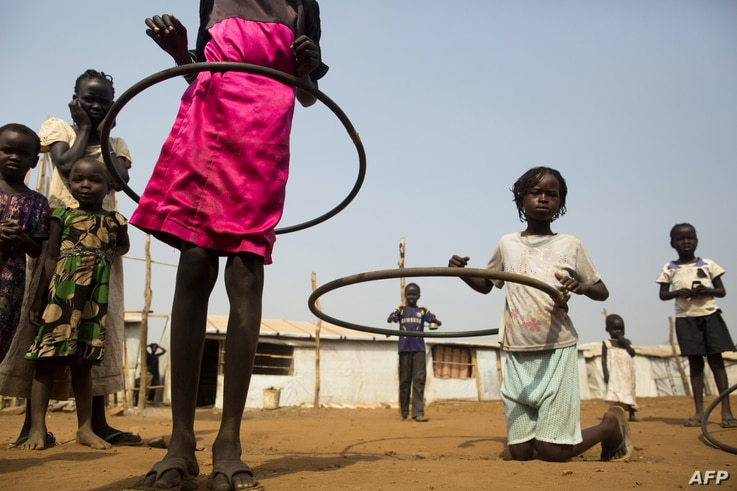 FILE - Children play with hula hoops at the Children Friendly Space, run by UNICEF at the United Nations Missions in South Sudan (UNMISS) Protection of Civillians (PoC) site, in Juba, South Sudan, Jan. 15, 2016.