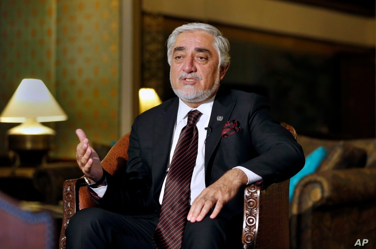 Abdullah Abdullah, chairman of Afghanistan's High Council for National Reconciliation, speaks during an interview with The Associated Press, in Islamabad, Pakistan, Sept. 30, 2020.