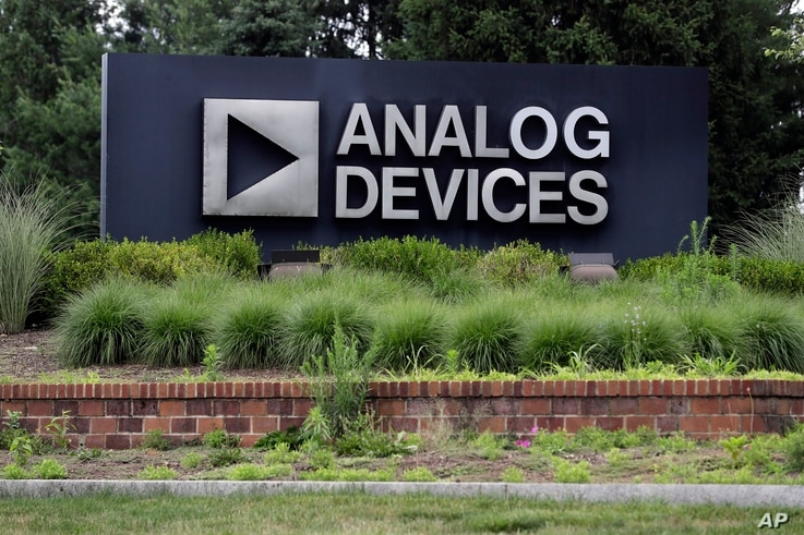 A sign points toward the headquarters of Analog Devices, Inc., July 13, 2020, in Norwood, Massachusetts.