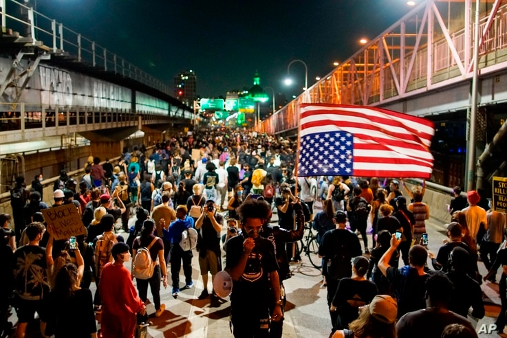 Demonstrators march on the Williamsburg Bridge during a protest in New York City, Sept. 23, 2020, following a Kentucky grand jury's decision in the police shooting death of Breonna Taylor.