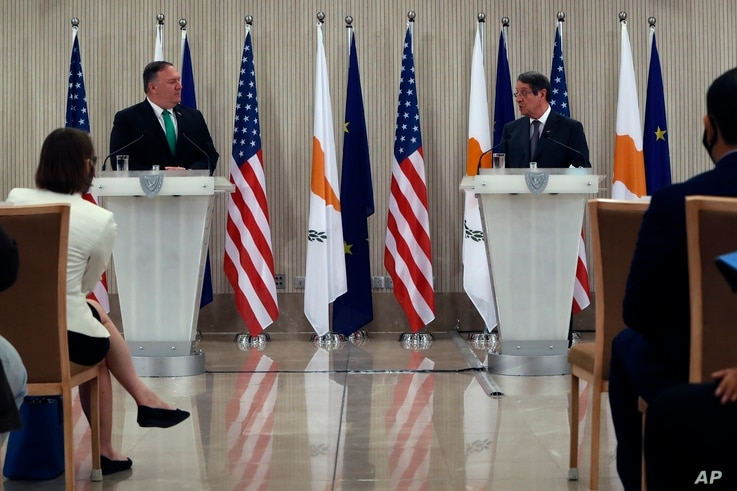 U.S. Secretary of State Mike Pompeo, left, and Cypriot President Nicos Anastasiades make statements during a press conference at the Presidential Palace in Nicosia, Cyprus, Sept. 12, 2020.