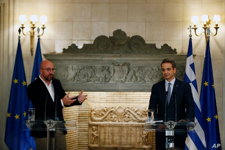 European Council President Charles Michel, left, makes statements after his meeting with Greece's Prime Minister Kyriakos Mitsotakis at Maximos Mansion in Athens, Sept. 15, 2020.
