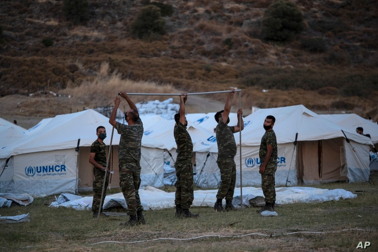 Greek soldiers set up UNHCR tents to accommodate asylum seekers left without shelter after fires on Lesbos Island, Greece, Sept. 11, 2020.