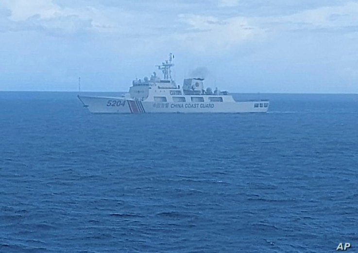 FILE - This undated file photo released on Sept. 15, 2020, by Indonesian Maritime Security Agency (BAKAMLA) shows a Chinese Cost Guard ship sails in North Natuna Sea.