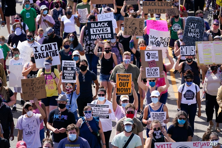 FILE - Hundreds march at a rally against racial inequality and police accountability, in Kenosha, Wisconsin, Aug. 29, 2020.