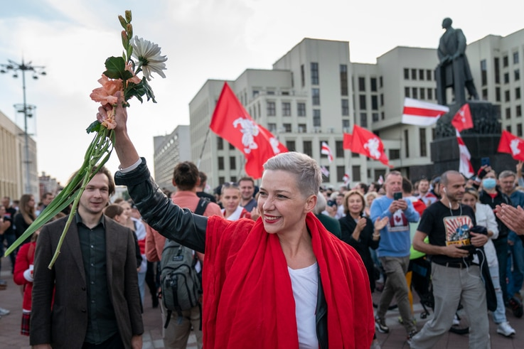 FILE - Belarusian opposition activist Maria Kolesnikova greets protesters during a rally at Independence Square in Minsk, Belarus, Aug. 22, 2020.