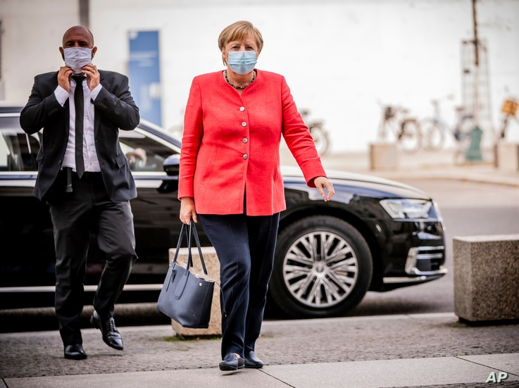 FILE - Chancellor Angela Merkel arrives for a meeting of her Christian Union parties faction at the Reichstag building in Berlin, Germany, Sept. 8, 2020.