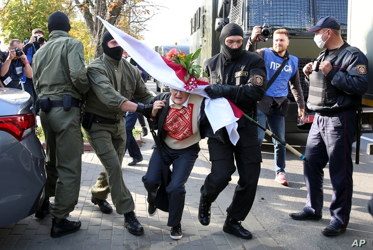 Police officers detain Nina Baginskaya, 73, during an opposition rally to challenging official presidential election results in Minsk, Belarus, Sept. 19, 2020.